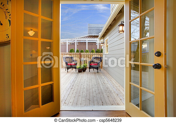 View of the deck from open kitchen french door - csp5648239