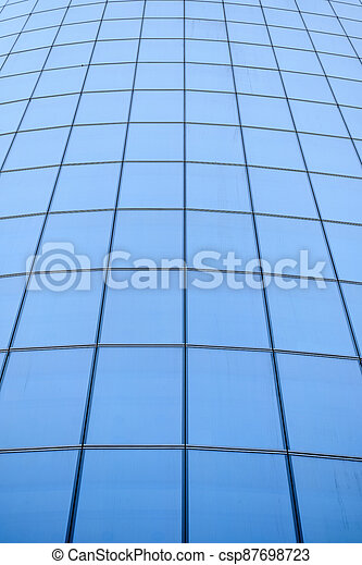 View of the facade of a modern glass skyscraper. - csp87698723