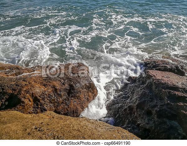 View of the Mediterranean sea breaking against the rocks - csp66491190