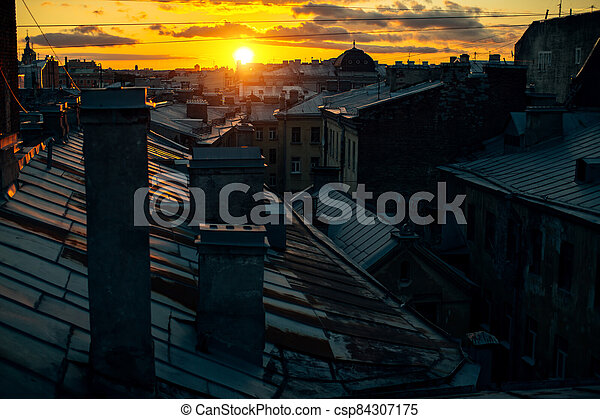 View of the roofs in Sankt Petersburg old town during sunset. Russia. - csp84307175