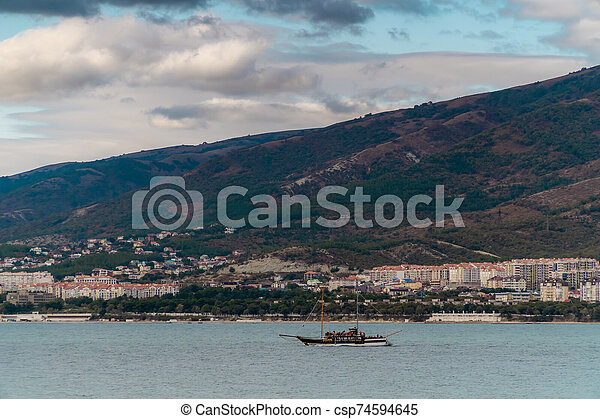 View of the southern resort town of Gelendzhik against the mountains. - csp74594645