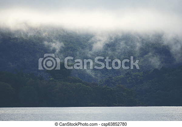view of tropical forest with lake, Thailand - csp63852780