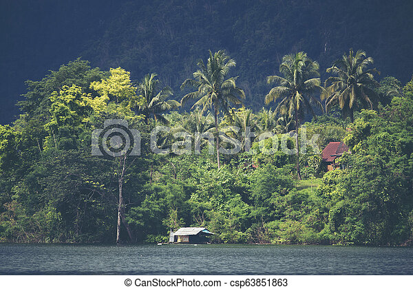view of tropical forest with lake, Thailand - csp63851863