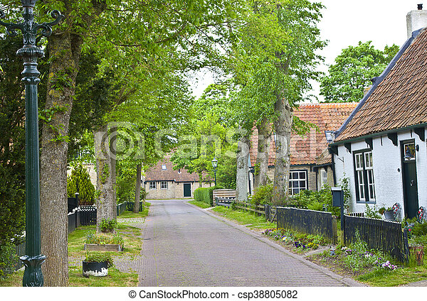 View of typical historic street in Ameland, The Netherlands - csp38805082