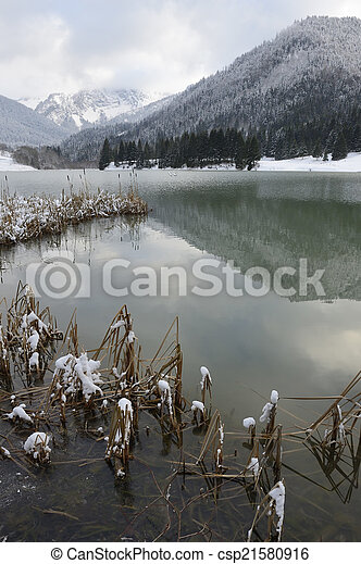 View on a mountain lake in winter. - csp21580916