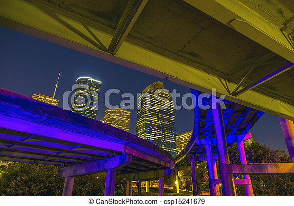 View on downtown Houston by night with bridges in colorful light with skyscraper - csp15241679