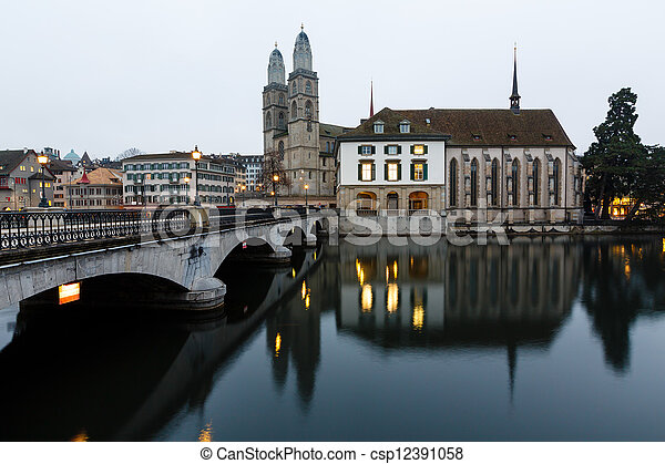 View on Grossmunster Church and Zurich Downtown in the Evening, Switzerland - csp12391058