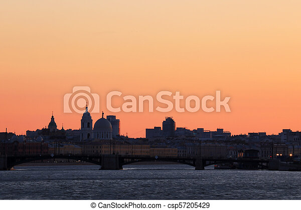 View on the Exchange Bridge in the rays of sunset between Petrogradsky Island and Vasilievsky Island in St. Petersburg, Russia. - csp57205429