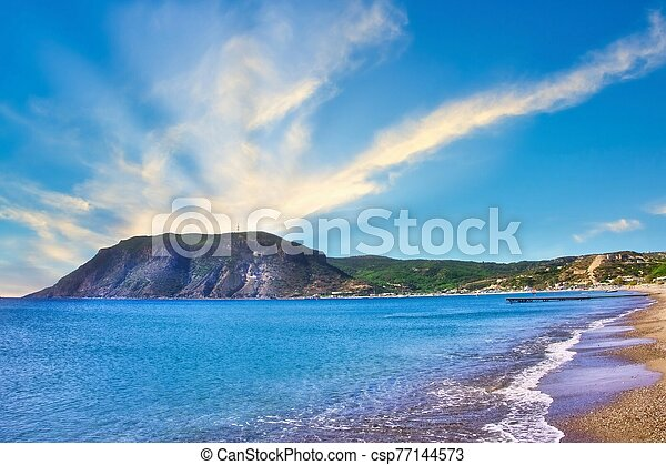 View on the rock from the Agios Stefanos Bay beach on Kos island - csp77144573