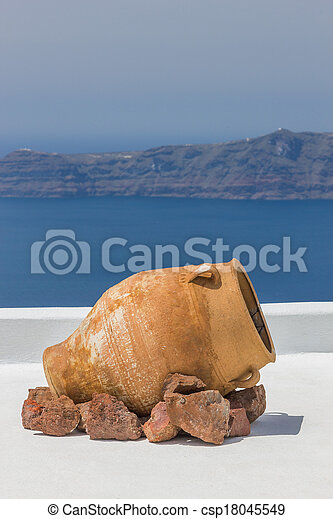 View out to sea over the white walls of Santorini - csp18045549