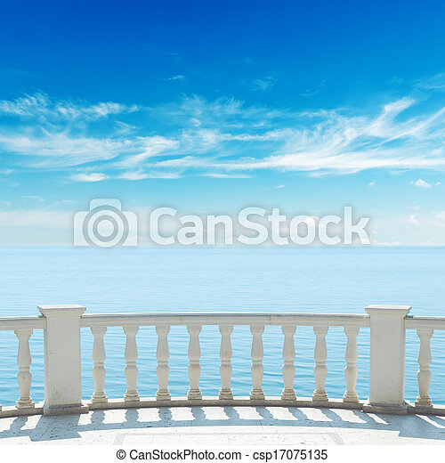 view to sea from terrace with balcony under cloudy sky - csp17075135