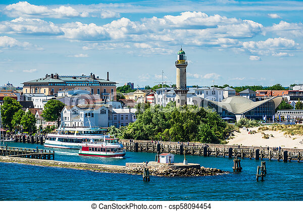 View to the lighthouse in Warnemuende, Germany - csp58094454