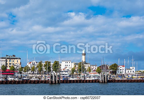 View to the lighthouse in Warnemuende, Germany - csp60722037