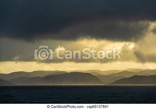 View to the Lyngdalsfjord with sunset in Norway - csp65137841