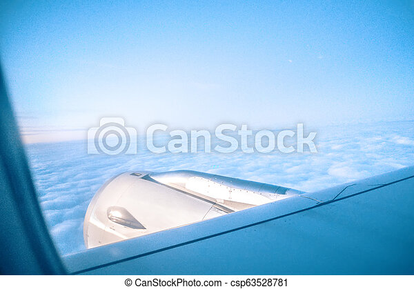 views out the window of an airplane - csp63528781