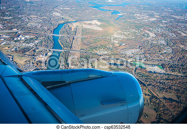 views out the window of an airplane - csp63532548