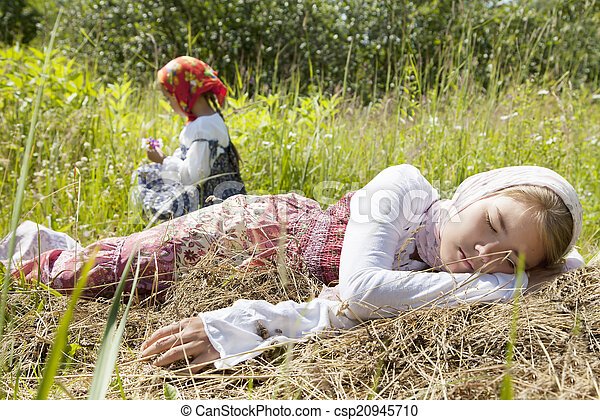 Village girls in a field - csp20945710