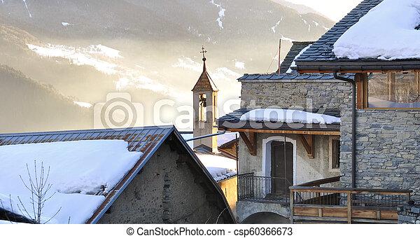 village in winter at sunset - csp60366673