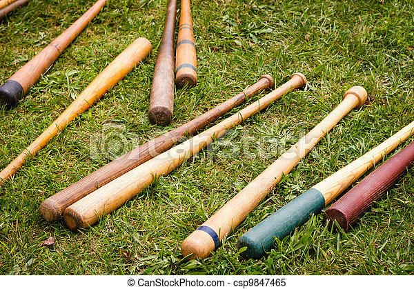 Vintage Baseball Bats Scattered on the Ground - csp9847465