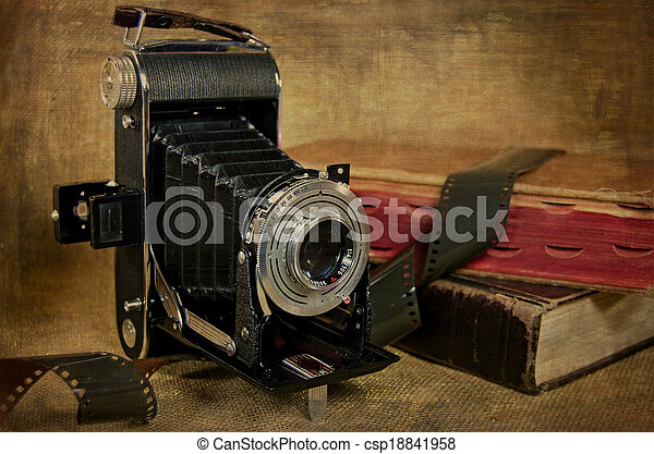 vintage bellows camera with film - csp18841958