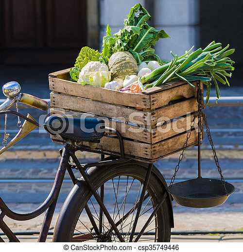vintage bicycle with fruit and vegetables - csp35749446