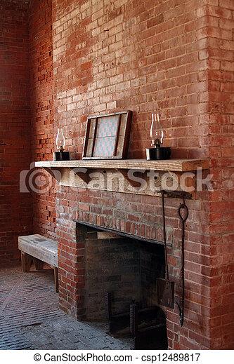 Vintage brick fireplace - csp12489817