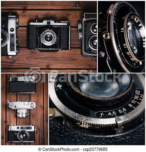 Vintage camera on wooden background - csp23779685