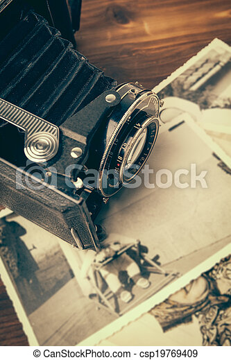 Vintage camera on wooden background - csp19769409