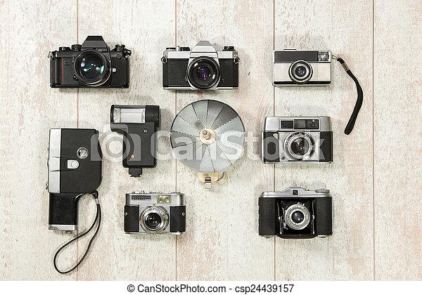 Vintage Cameras With Flash On Floorboard - csp24439157