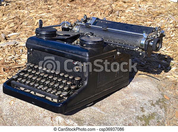 00283d9fb46 Vintage carriage typewriter. An old black carriage typewriter with a ...