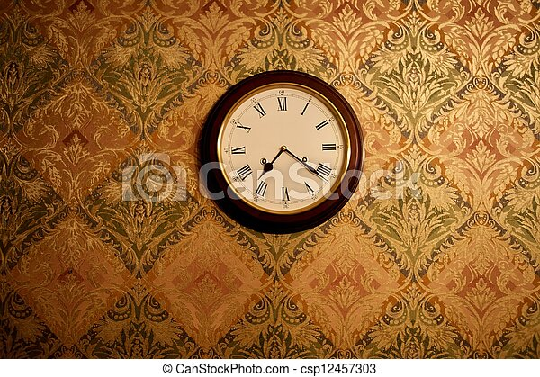 Vintage clock on a wall - csp12457303