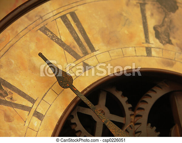 vintage clock close up of antique clock face showing hands and cogs