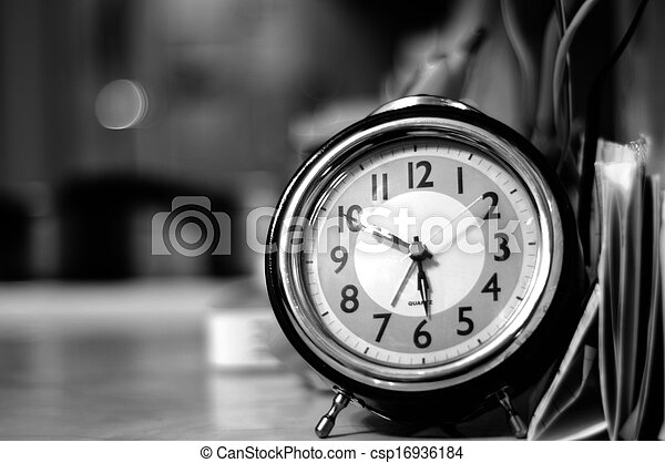Vintage clock on the table black and white photography
