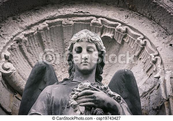 vintage close up of an angel sculpture - csp19743427