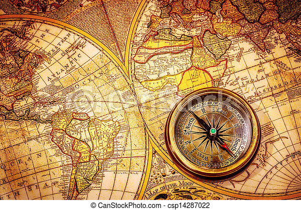 Vintage compass lies on an ancient world map. - csp14287022