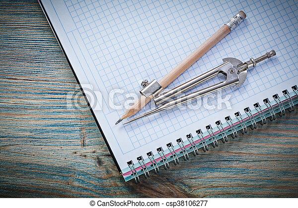 Vintage divider pencil checked copybook on wooden board construc - csp38106277
