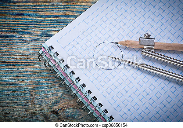 Vintage drawing compass pencil checked copybook on wood board co - csp36856154