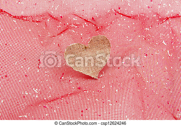 vintage fabric heart on rose background - csp12624246