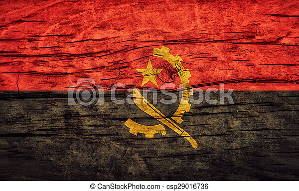 Vintage flag of Angola on a wooden surface - csp29016736