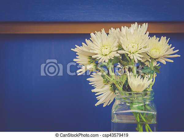 vintage flower pot decoration on wall - csp43579419