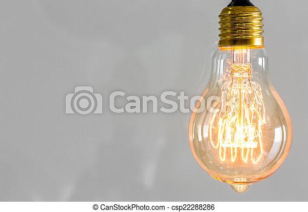 Vintage glowing light bulb - csp22288286