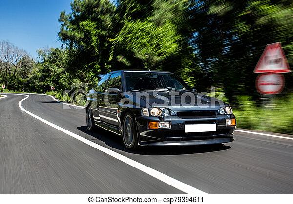 Vintage grey sedan car on the road - csp79394611