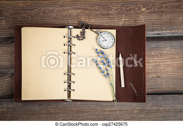 Vintage grunge still life with pocket watch, lavender flower and old book. - csp27425675