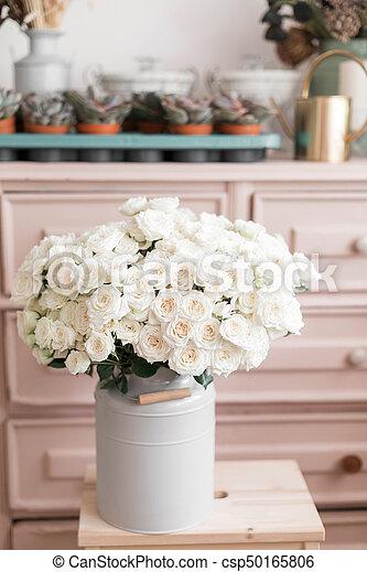 vintage interior decoration pink pastel closet white roses in metal bucket.