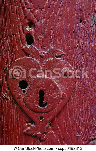 Vintage keyhole in an old red door - csp50492313