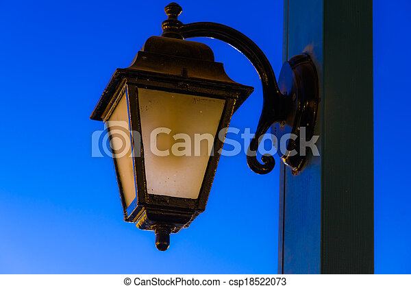 vintage lamp on a pole in the evening after sunset - csp18522073