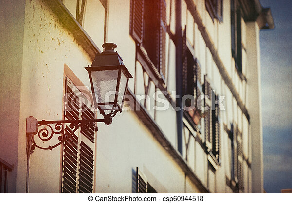 Vintage lamp on attached to the wall of the building - csp60944518