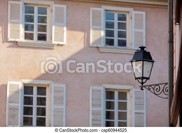 Vintage lamp on attached to the wall of the building - csp60944525