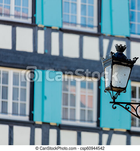 Vintage lamp on attached to the wall of the building - csp60944542