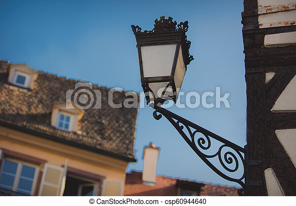 Vintage lamp on attached to the wall of the building - csp60944640